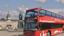 Unterwegs mit dem roten Doppeldeckerbus